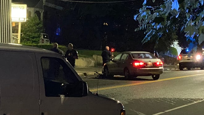 Police and paramedics at a fatal crash scene on Lincoln Street Thursday night.