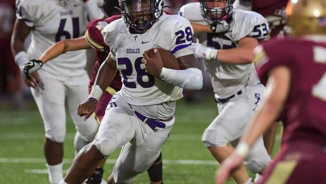 DeSales' Quintell Quinn looks for running room against Watterson on Aug. 28.