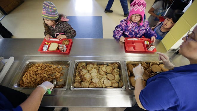 Elementary school students pick from two entrees at the cafeteria during lunch at Franklin Elementary Feb. 13.