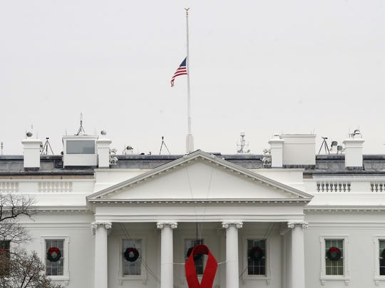 The American flag flies at half-staff at the White House on Dec. 1, 2018. President Donald Trump on Friday, Feb. 8, 2019, ordered flags flown at half-staff at the White and other federal buildings and military facilities in honor of former U.S. Rep. John Dingell, D-Dearborn.