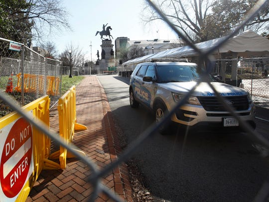 Fencing and magnetometers are set up around Capitol Square in Richmond, Va., on Sunday, ahead of an anticipated pro-gun rally.