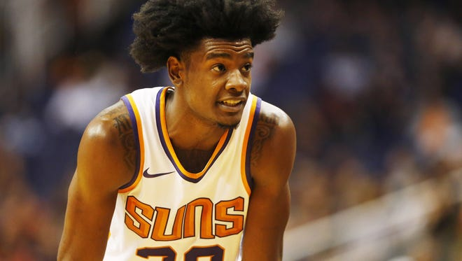 Phoenix Suns forward Josh Jackson (20) waits for play to resume against the Portland Trail Blazers during the third quarter in pre-season NBA action at Talking Stick Resort Arena in Phoenix, Ariz. October 11, 2017.