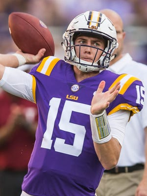 Tigers quarterback Myles Brennan (15) warms up before the Tiger's non-conference game against Troy on Saturday Sept. 30, 2017.