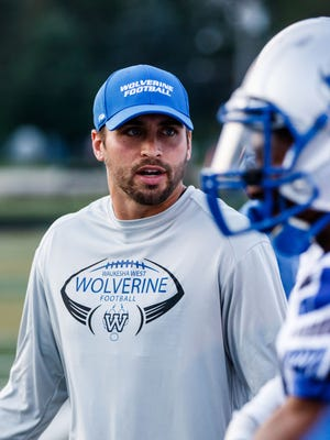 Waukesha West assistant coach Jack Moro talks with players during the game at Kettle Moraine on Friday, August 18, 2017.