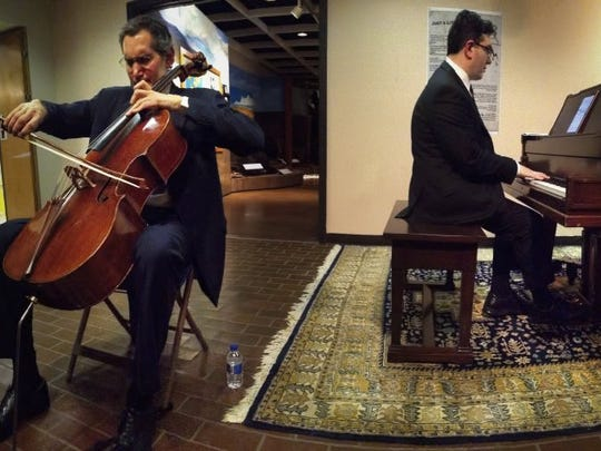 Evan Drachman (left) and Jeffrey Grossman perform at the Scurry County Museum Monday, Feb. 3, 2014. The musicians were touring west Texas for the Piatigorsky Foundation, bringing classical music to small towns. The program was one of the ways Executive Director Daniel Schlegel, Jr. tried to engage the community beyond the exhibits of the museum.