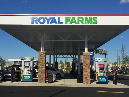 Gas pumps serve patrons outside the new Philadelphia outlet for Maryland-based Royal Farms.
