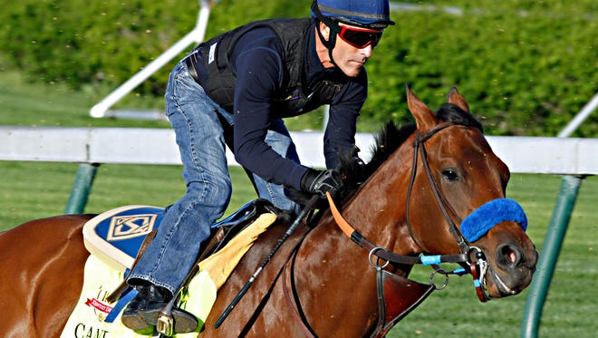 Jockey Gary Stevens rides Kentucky Derby hopeful Candy Boy in his final timed workout for the 140th Kentucky Derby at Churchill Downs in Louisville, Ky., Saturday, April 26, 2014.