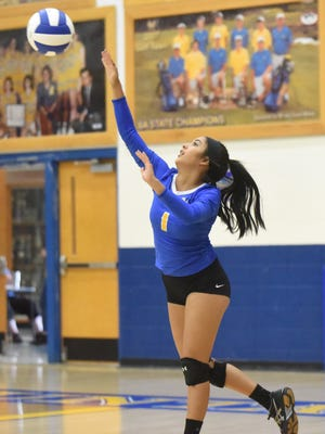 Mountain Home's Paola Crim serves during a recent match.