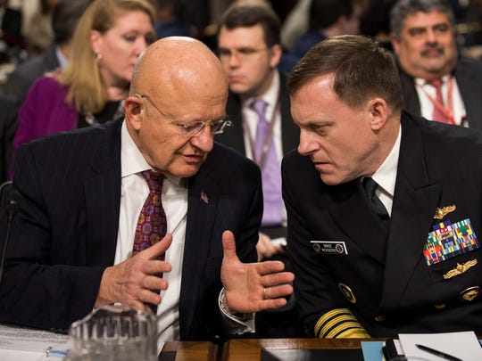 Director of National Intelligence James Clapper Jr., and National Security Agency and Cyber Command Chief Michael Rogers prepare to testify before a Senate Armed Services Committee hearing on Jan. 5, 2017.