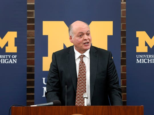 Jim Hackett speaks after being introduced as Michigan's interim athletic director during a news conference in Ann Arbor on Oct. 31, 2014.