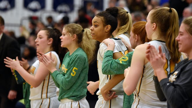York Catholic players applaud from the bench after winning a first-round PIAA Class 3A girls' basketball game Friday, March 9, 2-18, at West York. York Catholic defeated Mastery Charter South 62-40 to advance in the tournament.