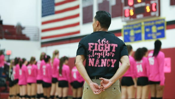 Nyack volleyball coach Christian Collazo wears a t-shirt