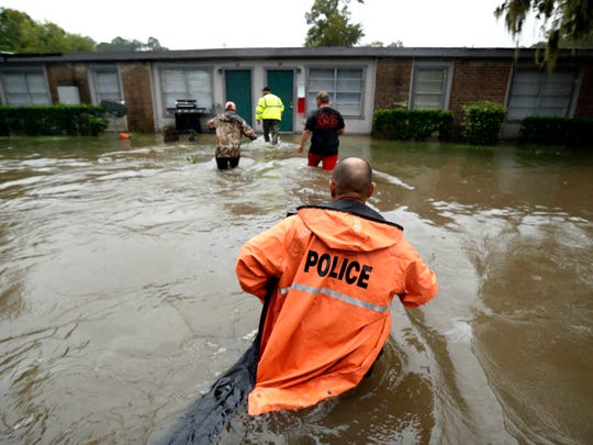 Volunteers assist police in making welfare checks on flooded homes Aug. 28, 2017, in Dickinson, Texas, in the wake of Tropical Storm Harvey. More than 40 inches of rain fell around Dickinson.