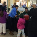 Green Bay Packers players Matt Flynn and Scott Tolzien ring bells for the Salvation Army on Monday at Bay Park Square Mall.