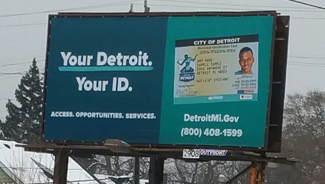Billboards like this are going up in Detroit to remind residents of the city's new municipal ID card for those who have difficulty getting driver's licenses or other state IDs.