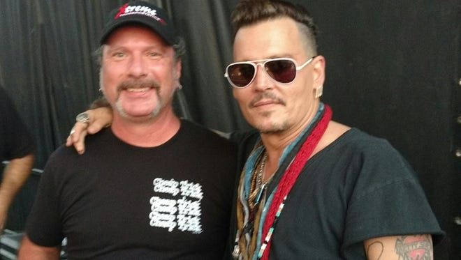 Stephen Funke of Green Bay, left, grabs a photo with actor/musician Johnny Depp while out on the road with Cheap Trick. Funke is the sound monitor engineer for the rock band and is up for  Best Live Engineer Sound/Lights at this weekend's Wisconsin Area Music Industry Awards in Milwaukee.