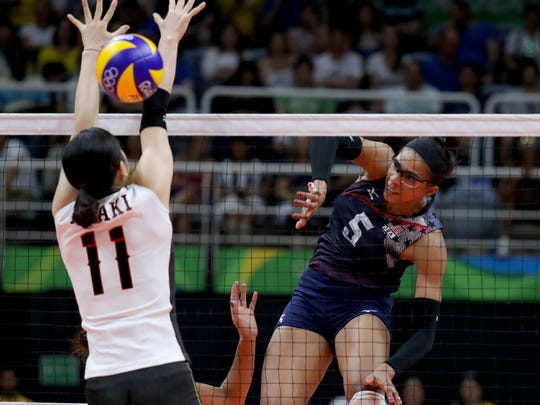 Japan middle blocker Erika Araki (11) attempts to block a spike by United States middle blocker Rachael Adams during a women's volleyball match between USA and Japan at Maracanazinho during the Rio 2016 Summer Olympic Games.