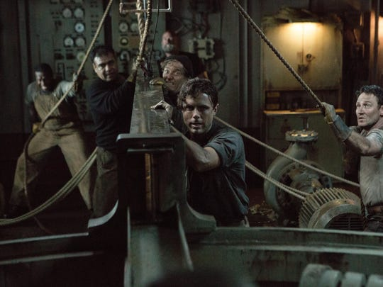 """Ray Sybert (Casey Affleck) and Tchuda Southerland (Josh Stewart) struggle to keep their ship, the SS Pendleton, from sinking in Disney's """"The Finest Hour."""""""