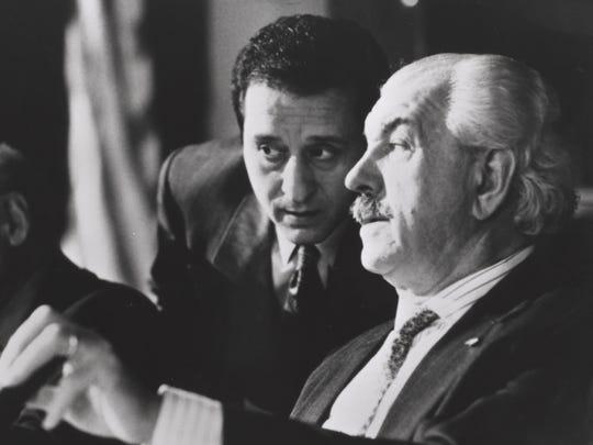 Louis Zorich (right) as Mayor Baci, and Joe Grifasi