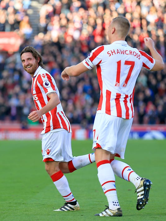 Stoke City's Joe Allen celebrates scoring his side's second goal of the game during the English Premier League soccer match at the Bet365 Stadium, Stoke. England, Saturday Oct 15, 2016. (Nigel French/PA via AP)