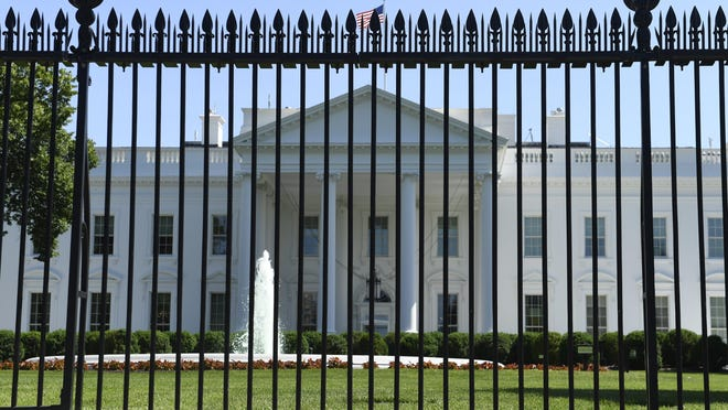 The fence surrounding the White House on Pennsylvania Avenue in Washington, Friday, May 24, 2019. Approval was given for a new and taller fence around the White House complex in 2017 and now construction of a almost 13-foot tall fence is slated to begin this summer.