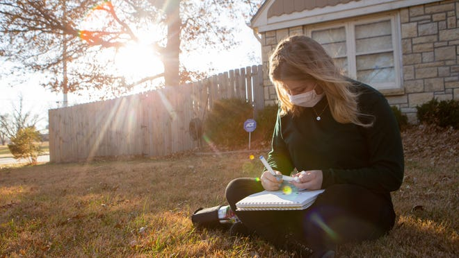 Katelyn Arnold, of Topeka, sits outside her home Thursday afternoon drawing, one of her many hobbies. Since the fifth grade, Arnold has been treating her anxiety through Family Service and Guidance Center's anxiety treatment program.