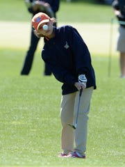 Emerson Blair of West Point chips onto the green during