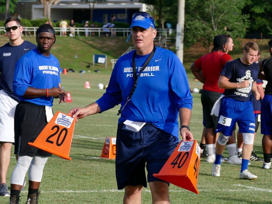 UWF football coach Pete Shinnick directs prep players
