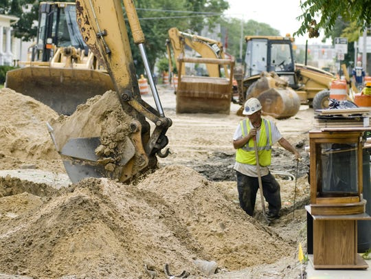 This file photo shows workmen digging out a waterline