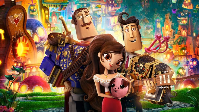 """""""The Book of Life"""" features Joaquin (voice of Channing Tatum), left, Manolo (Diego Luna)  and Maria (Zoe Saldana)."""