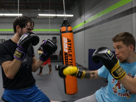 Gary Konkol (right) works with a sparring partner in preparation for his MMA amateur featherweight title fight Sept. 1 at the Holiday Inn in Stevens Point.