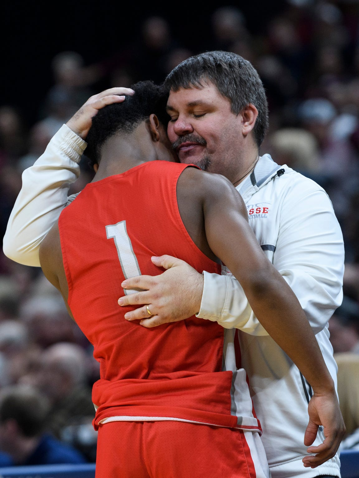 "Shane Burkhart hugs Bosse's Jaylin Chinn at the end of the Bulldogs' loss to Culver Academies in the Class 3A state title game in March. It was the Bulldogs' worst game of the season, Burkhart said, ""at the worst time."""