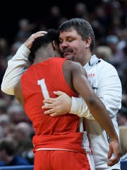 Bosse's Jaylin Chinn (1) recieves a hug from Bosse Head Coach Shane Burkhart at the end of the fourth quarter against the Culver Academies Eagles in the IHSAA Class 3A State Championship at Bankers Life Fieldhouse in Indianapolis, Saturday, March 24. The Bulldogs were defeated by the Culver Academies Eagles, 64-49.