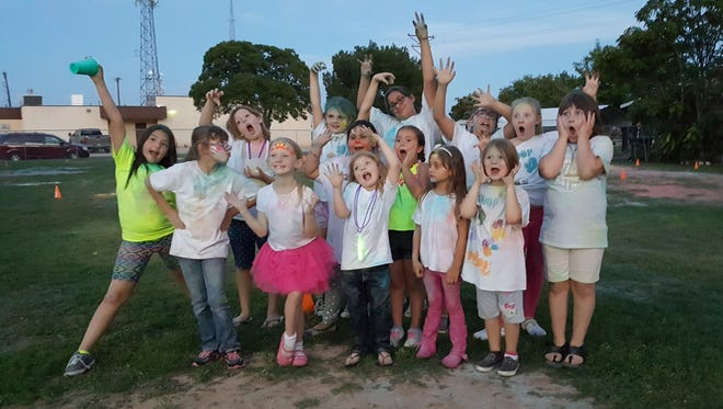 Girl Scouts troop 12001 hosted a back-to-school color run and glow party on Aug. 27.