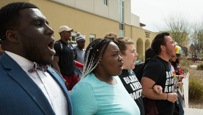 Members of the Black Students Association at New Mexico State University organized a March on NMSU on Tuesday, Feb. 27, 2018, gathering in front of the Student Educational Services Building and marching to the Hadley Hall administration building, where Meligha Garfield, the president of the Black Student Association read a list of demands the organization is seeking.