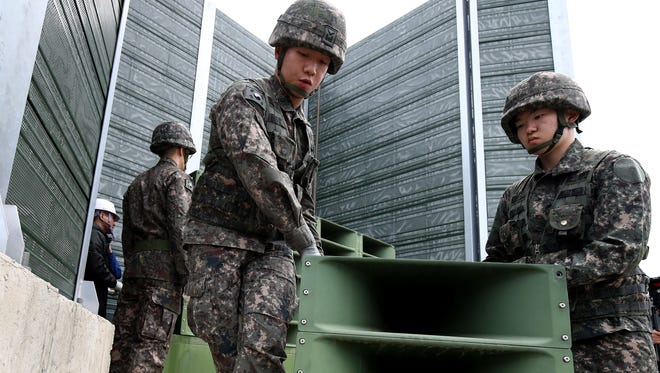 South Korean soldiers take down propaganda loudspeakers on the border with North Korea on May 1, 2018 in Paju, South Korea. South Korea's military pulled back all high-decibel loudspeakers installed along the border with North Korea in its first step to implement the bilateral summit agreement reached last week.