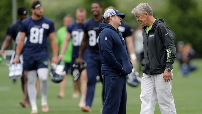 Seahawks coach Pete Carroll, right, and general manager John Schneider got a look at what they have during last week's minicamp.