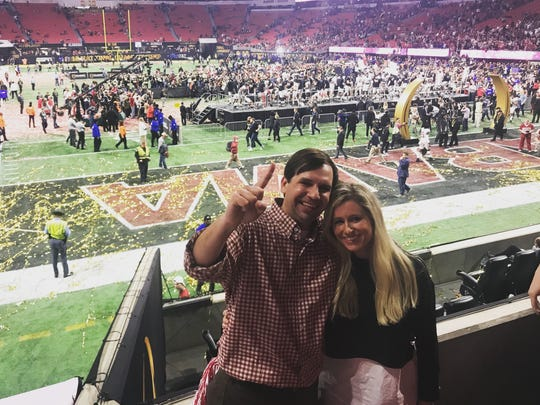 Spears Griffin, and his wife, Meagan at the national title post-game celebration in Atlanta