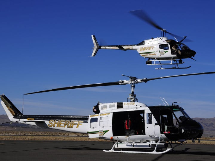 Two of the Washoe County Sheriff's Office's helicopters,