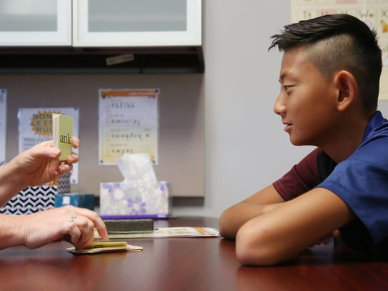 Gabe Califf, 13, of West Des Moines, is tutored by