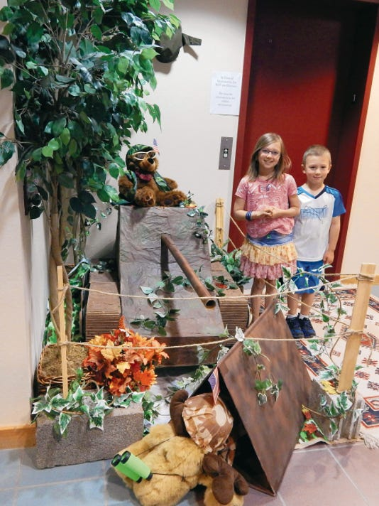 Leigh and Stephen Rath enjoy the camping exhibit at the Ruidoso Public Library.