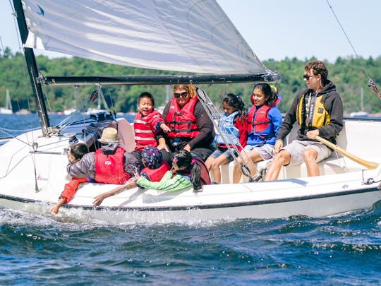 Youngsters enjoy the wind and water on one of the boats belonging to the Lake Champlain Community Sailing Center.