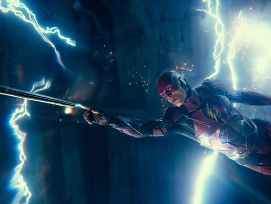 The Flash (Ezra Miller) helps out a fellow hero in