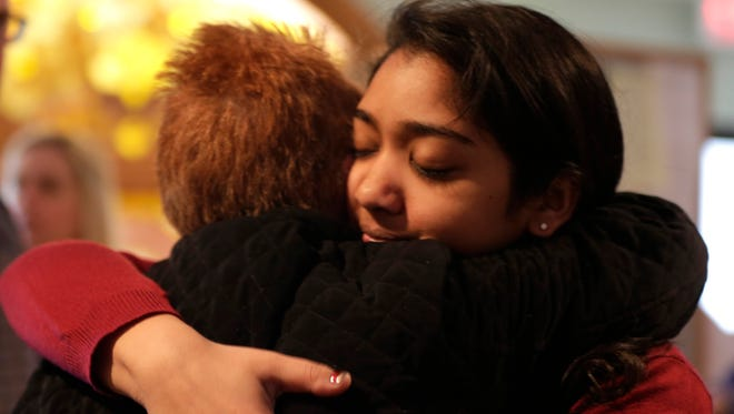 Nikita Deep, 16, embraces a family friend at Antigo United Methodist Church after a service the morning after a shooting at the Antigo High School prom, April 24, 2016. Deep is class president and was involved in the coordination of the prom.
