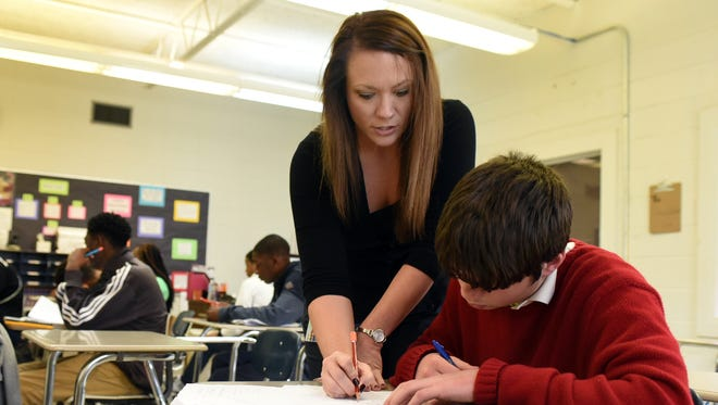 Algebra teacher Emily Mitchell helps her student Bubba Smith during a class period on Wednesday at North Forrest High School.