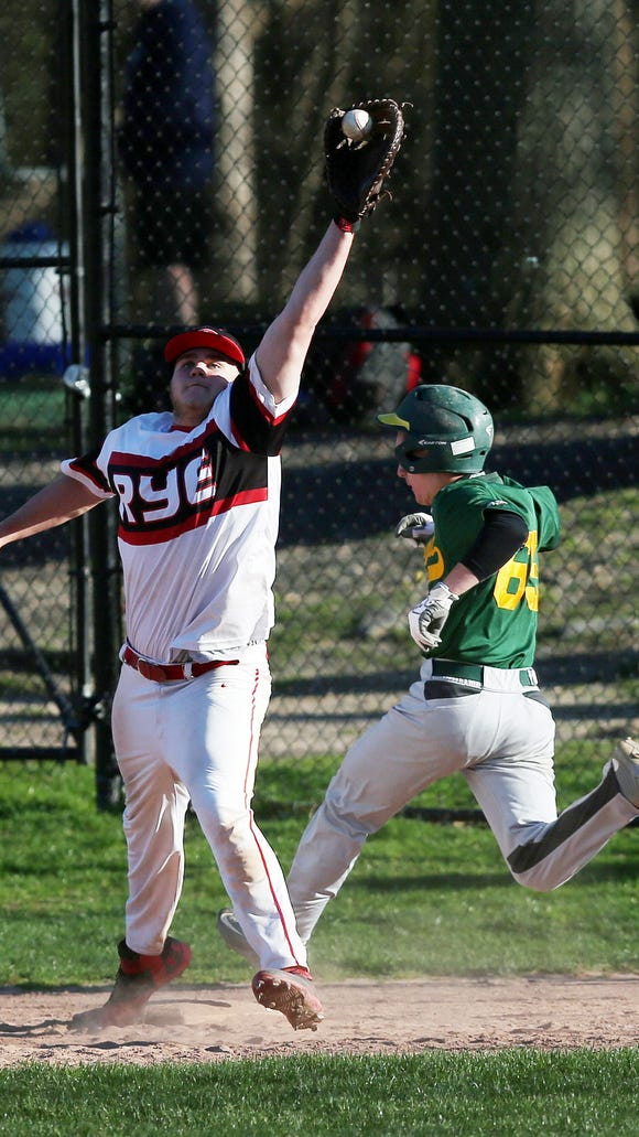 Lakeland's Evan Berta (65) beats out an infield hit in the 6th inning to break up Rye pitcher Declan Lavelle's no-hitter during boys baseball action at Disbrow Park in Rye April 15,  2017. Rye won the game 6-0.
