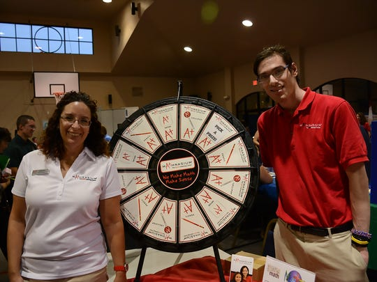 Leanne Flama and Jason Grant promoted their Mathnasium for math learning at the Extracurricular Expo on Monday.