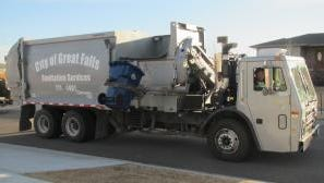 A propane canister exploded in the back of a city garbage truck Tuesday.