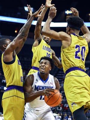 University of Memphis forward Victor Enoh (middle) drives to the basket against the LeMoyne-Owen defense during first half action at the FedExForum in Memphis, Tenn., Thursday, November 2, 2017.