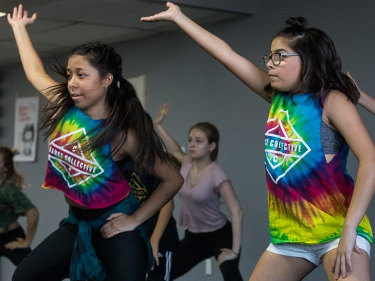Students learn a dance routine during a hip-hop class
